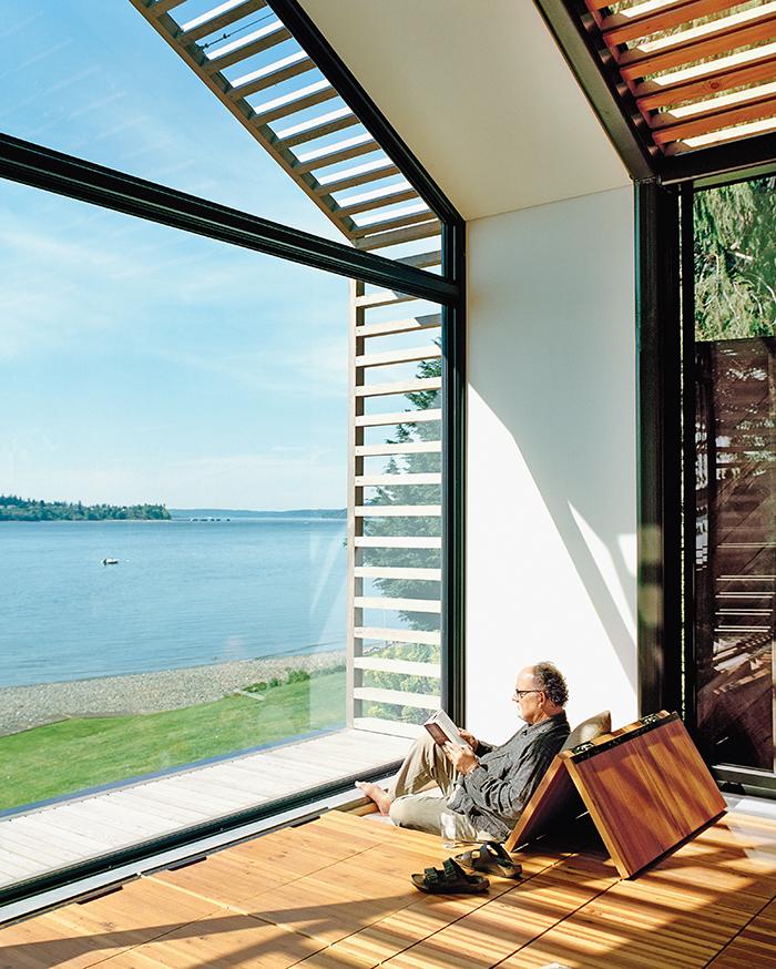 Reading nook facing glass wall facade in converted garage