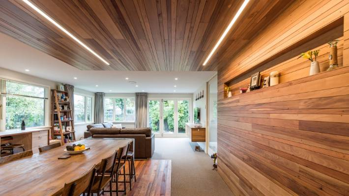 The timber wall and ceiling wrap is an example of the couple's reuse policy.