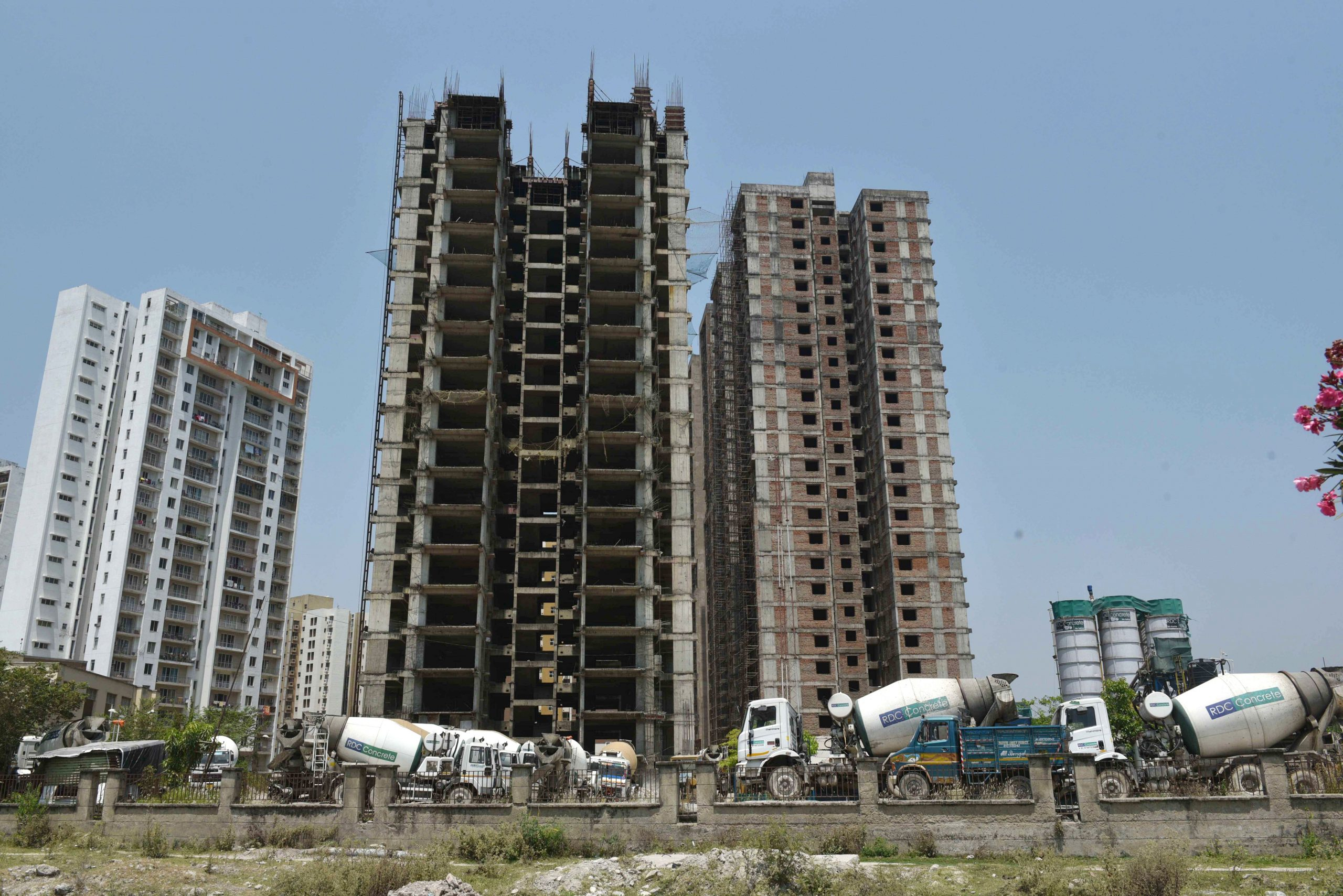 Concrete mixing machines line up at the construction site for high-rise buildings on April 10 in Kolkata, India.