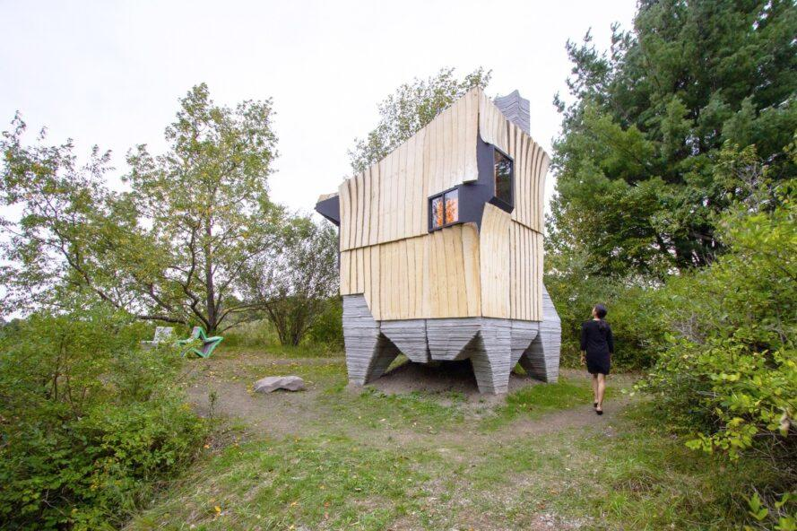 Angular cabin clad in ash wood