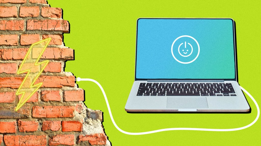 An image of a laptop plugged into a wall of red bricks