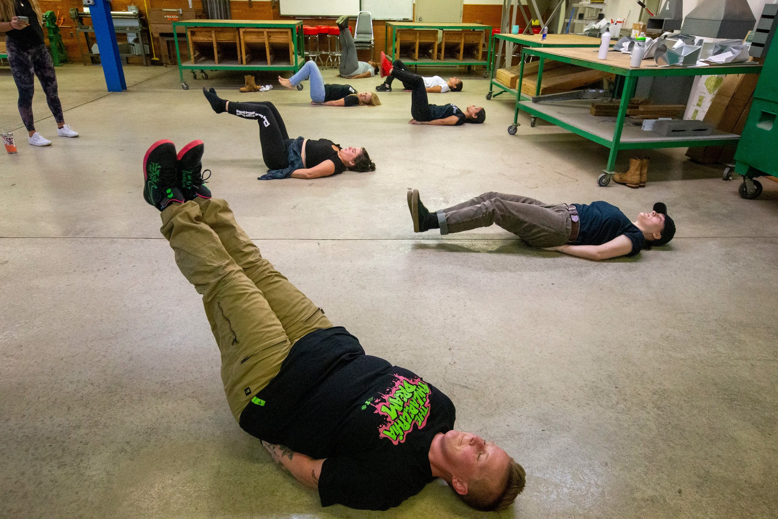 Christina McNeill of Northeast Philadelphia (front) and other class members work with a trainer on physical strengthening exercises during the pre-apprenticeship program.